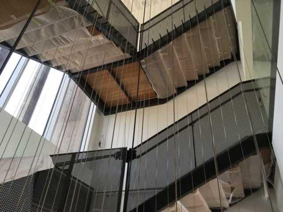 Escalier métallique avec main courant en inox - Saint-Brieuc (22) img1459